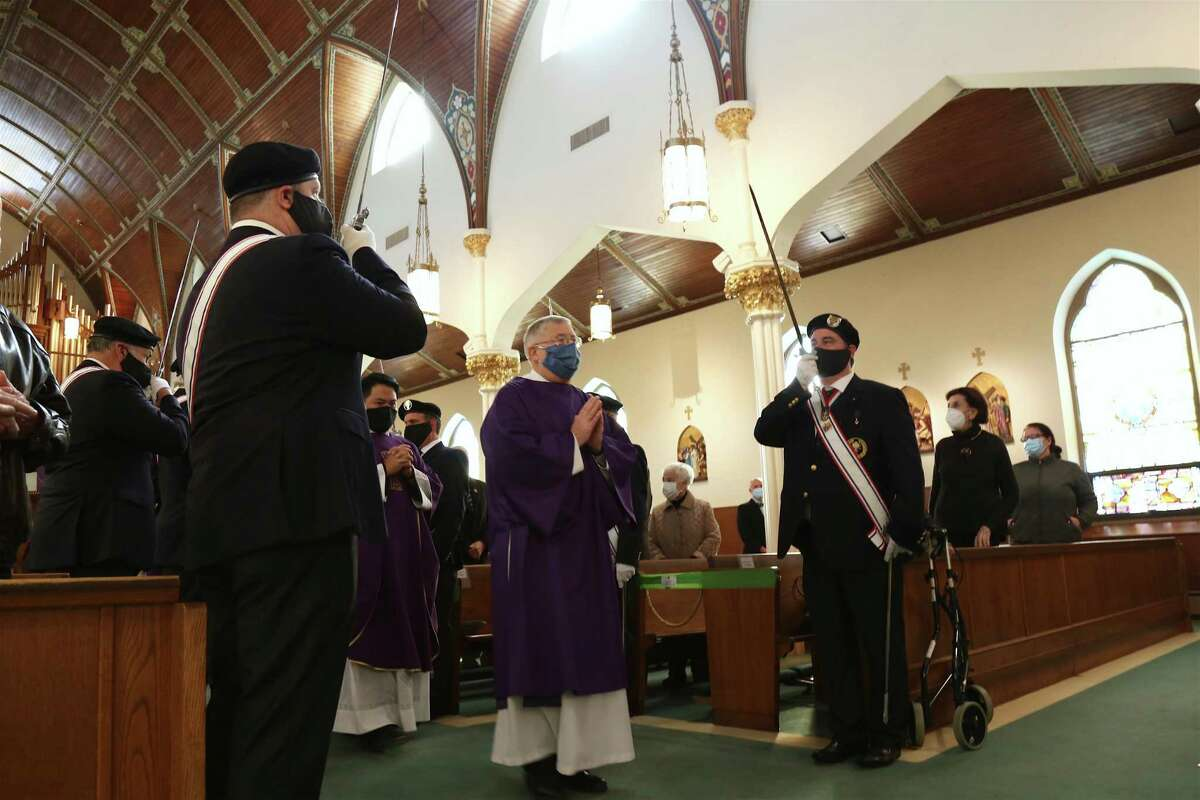 Deacon Bill Koniers and the honor guard.