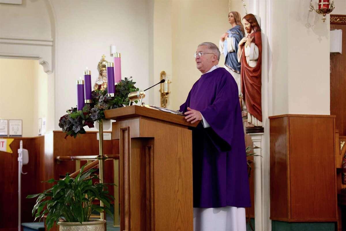 Deacon Bill Koniers talks about Jean Donovan at Sunday's service at Assumption Church in Westport, Conn., on Dec. 6, 2020.