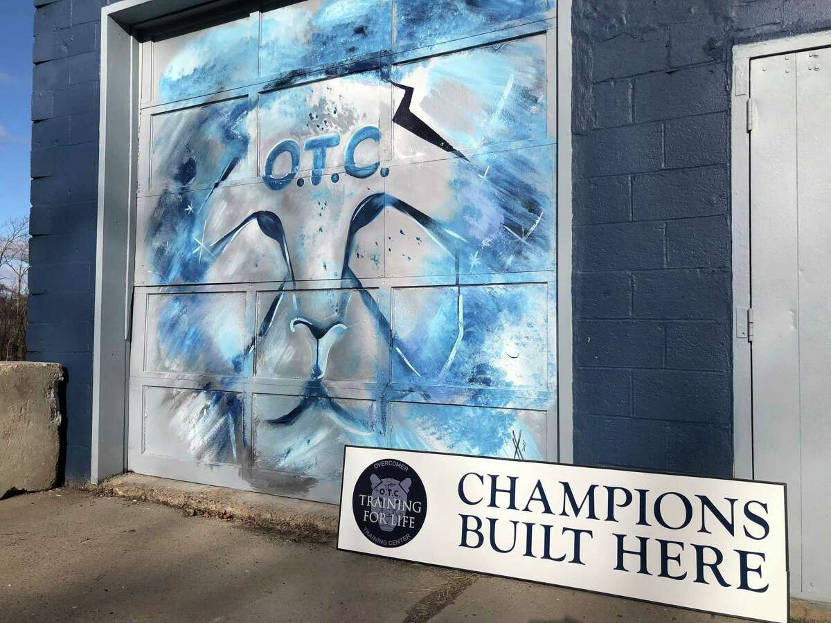 Local artist Enox Shabazz painted the artwork outside Overcomer Training Center on Walnut Street.