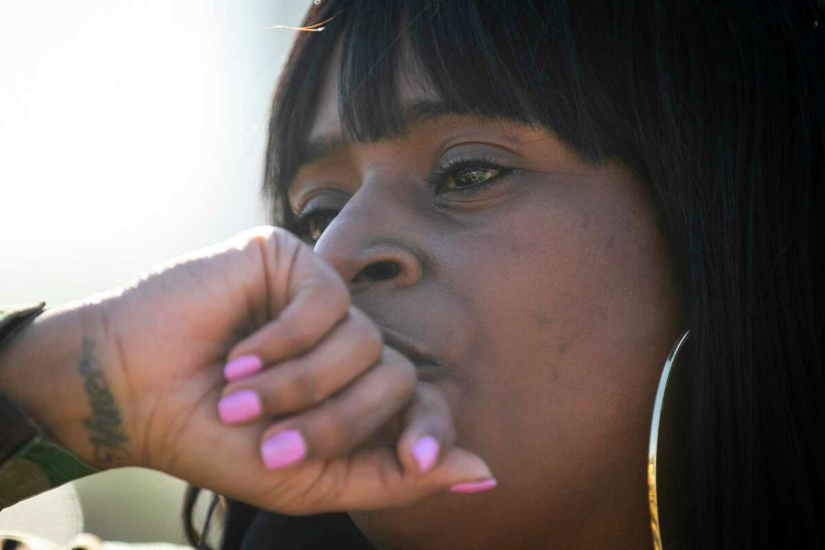 Kendra London becomes emotional as she describes the hardships in Fifth Ward during a protest walk in Fifth Ward on Dec. 6, 2020.