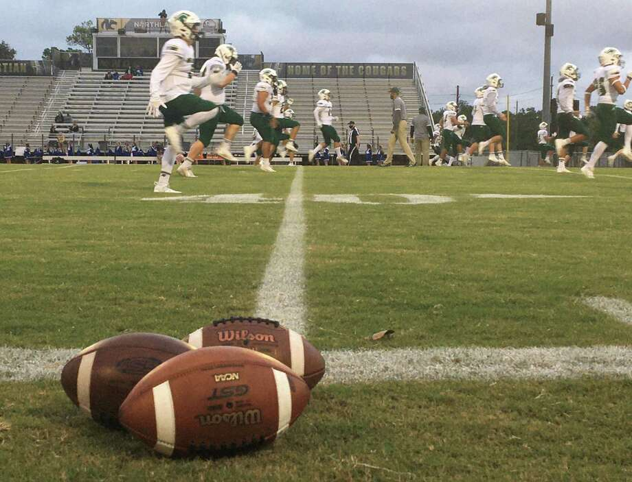 The Woodlands Christian Academy football team warms up prior to its game against Frassati Catholic on Friday, Oct. 23, 2020 at Northland Christian in Houston. Photo: Rob Tate / Staff Photographer