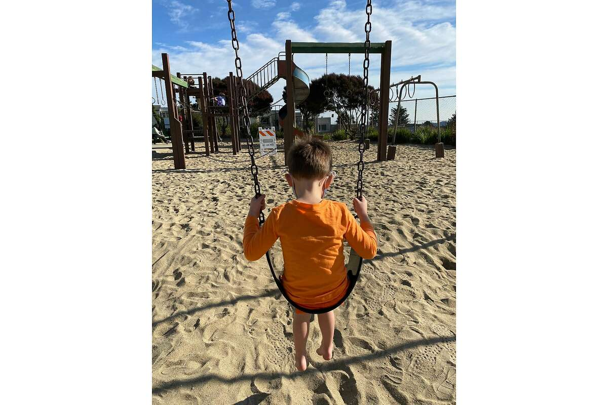 Wolfgang Helland, 4, sits on a swing at Miraloma Playground, his favorite park, on Dec. 6, 2020, just hours before it closes due to a new coronavirus stay-at-home order.