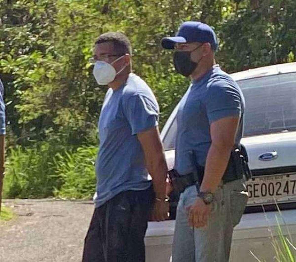 Davis Omar Roman Villanueva when he was taken into custody in Puerto Rico in October in connection with a Meriden, Conn., fatal shooting.