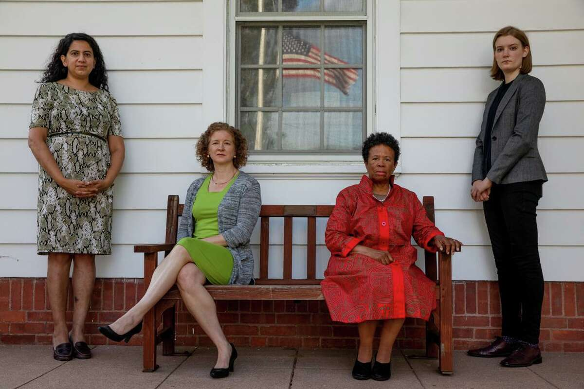From left, Anika Singh Lemar, Erin Boggs, Connie Royster and Karen Anderson pose for a portrait at the Woodbridge Town Hall on Monday, Sept. 28. Their team of lawyers will bring to the town hall on Tuesday an application to build a four-unit building on a two acre lot in Woodbridge that is zoned for only a single-family home.