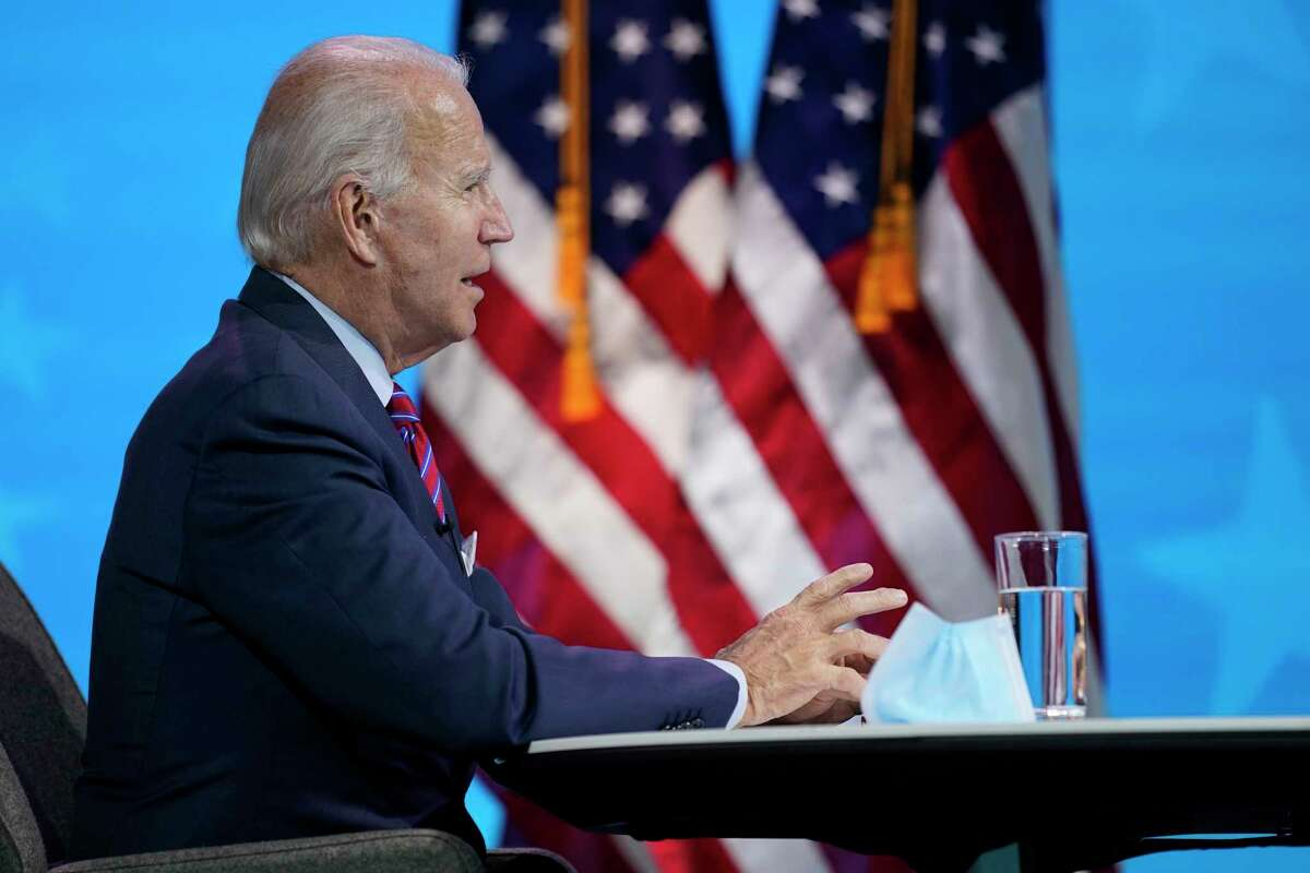 President-elect Joe Biden participates in a virtual meeting with the National Association of Counties Board of Directors about jobs at The Queen theater, Friday, Dec. 4, 2020, in Wilmington, Del.