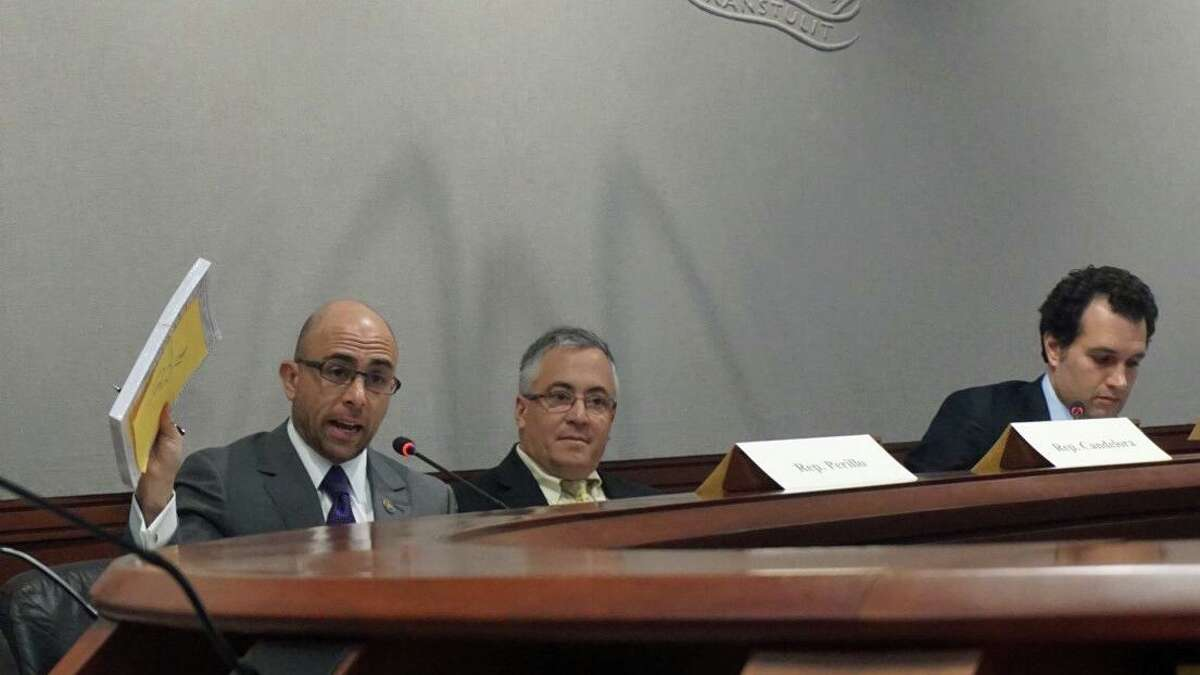 L to R: State Reps. Jason Perillo, R-Shelton, Vincent Candelora, R-North Branford, and Michael D'Agostino, D-Hamden, listen to testimony from witnesses from Stratford during a Committee on Contested Elections meeting on Thursday January 24, 2019 at the Legislative Office Building in Hartford, Conn.