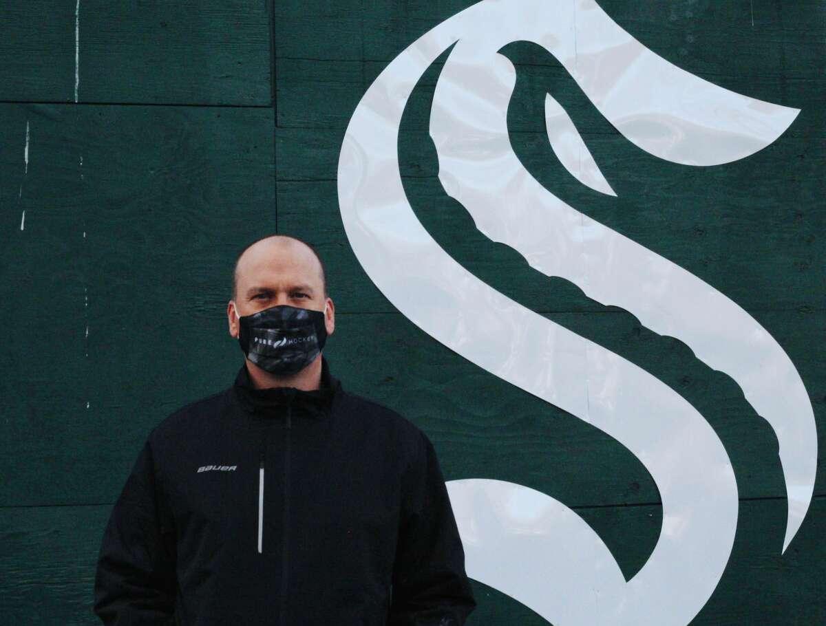 A Seattle Kraken fan stands outside Climate Pledge Arena on December 5, 2020 in Seattle.