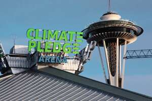 Climate Pledge Arena signage on the outside of the arena on December 5, 2020 in Seattle, Wash.