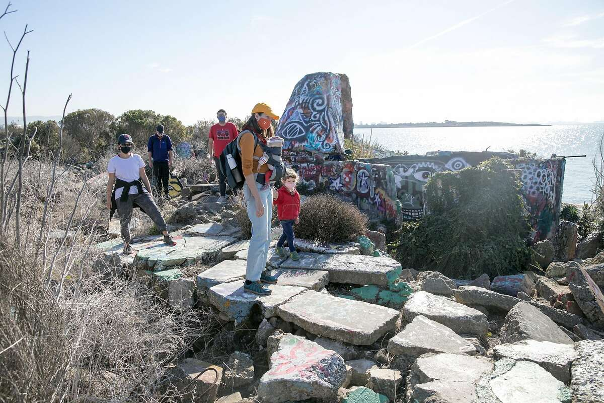 People view Mad Marc's Castle on the Albany Bulb on Dec. 2, 2020. The Bulb is a former construction debris landfill peninsula that sticks out into San Francisco Bay in Albany, Calif.