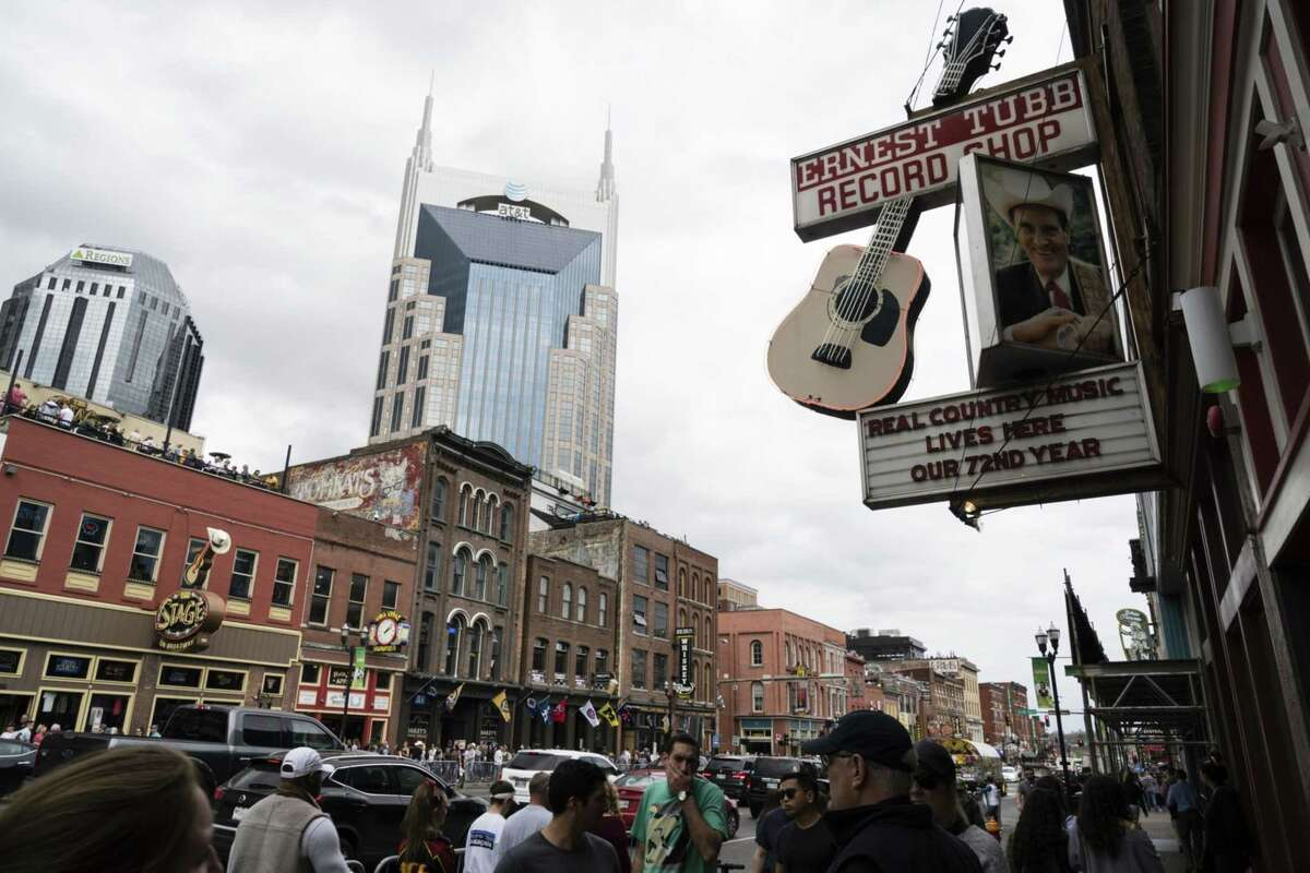 Pedestrians pass in front of Ernest Tubb Record Shop in downtown Nashville on April 1, 2019.