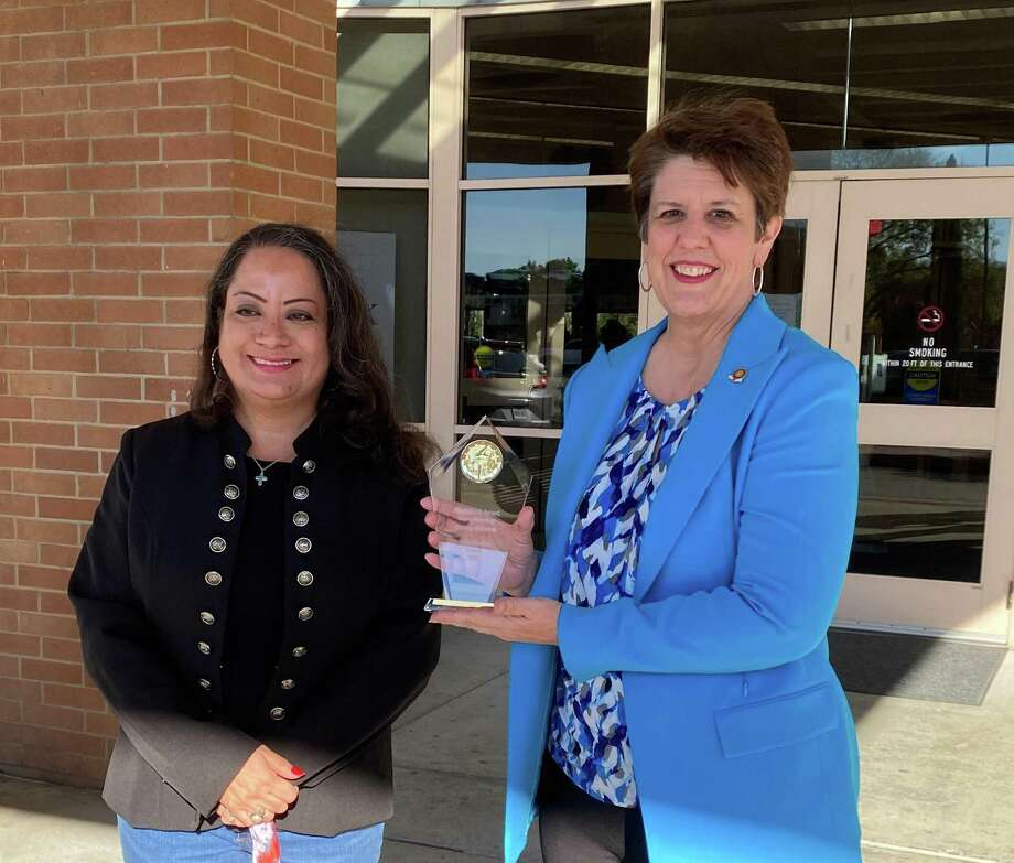 For her diligence in connecting the community with their local library, Montgomery County Memorial Library System Outreach Coordinator Devery Johnson has been awarded the Texas Familias Council's first Machiliztli Award. Johnson, right, is pictured with Maria Banos Jordan, left, when the award was presented on Friday afternoon. Photo: Photo By Sondra Hernandez