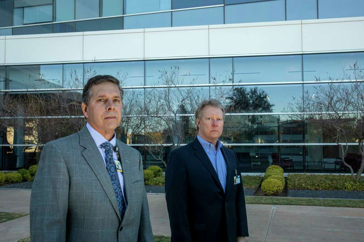 Dr. Larry Wilson and Midland Memorial Hospital president and CEO Russell Meyers pose for a portrait Monday Dec. 7, 2020 at MMH. Jacy Lewis/Reporter-Telegram