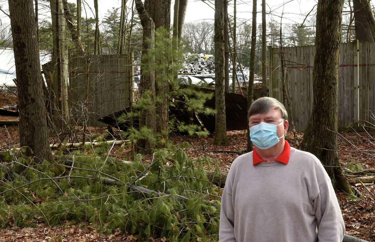 Michael Kaine stands in his backyard with a view of Planit Salvage behind him on Monday, Dec. 7, 2020 in Ballston Spa, N.Y. (Lori Van Buren/Times Union)