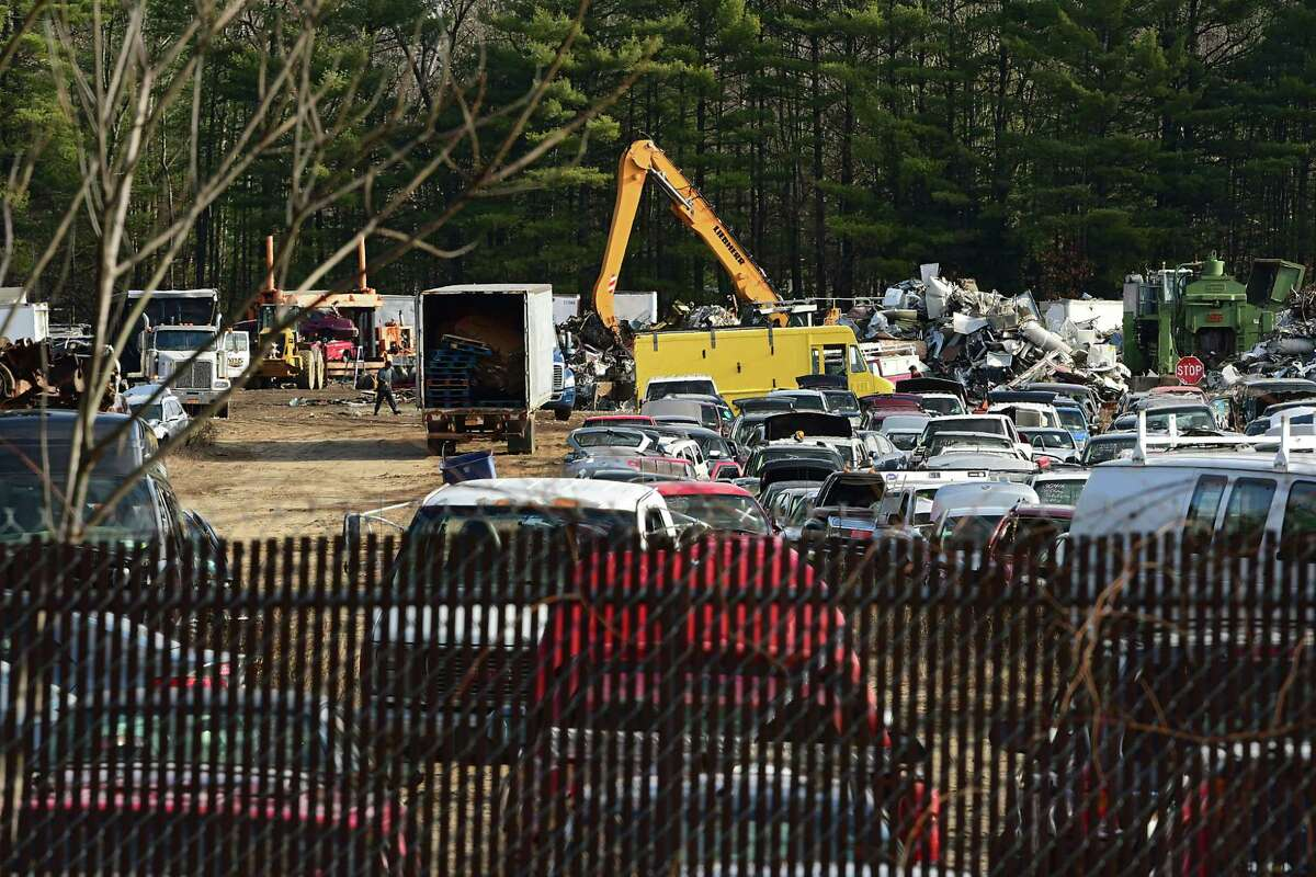 Metal debris piles and trashed cars at Planit Salvage are seen from deck of a home nearby on Monday, Dec. 7, 2020 in Ballston Spa, N.Y. (Lori Van Buren/Times Union)