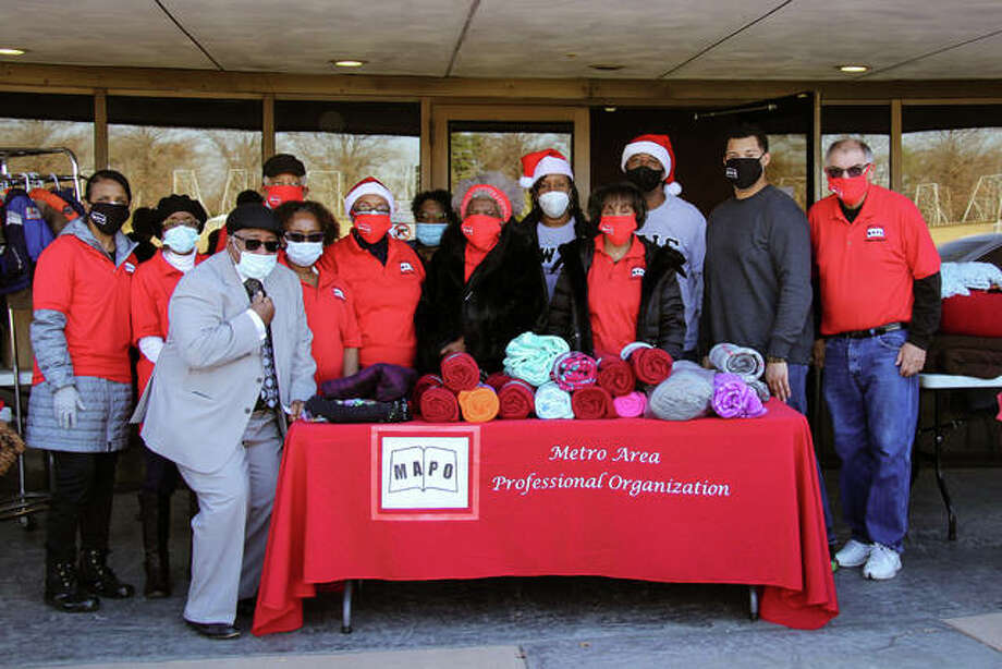 Metro Area Professional Organization (MAPO) hosted a Holiday Drive-By Giveaway at the National Shrine of Our Lady of Snows Saturday in Belleville. MAPO gave away more than 2,500 pairs of socks as well as blankets, coats, sweaters and other items to keep roughly 400 families warm this winter. Photo: Andrew Malo   For The Intelligencer