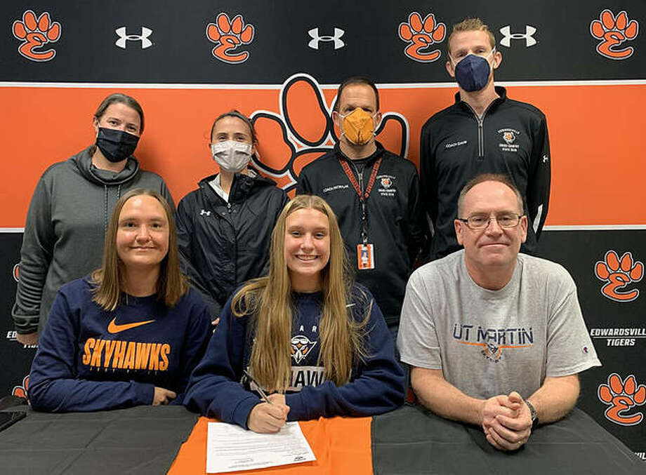 Edwardsville senior Katelyn Loyet, seated center, will run cross country and track and field at the University of Tennessee-Martin. She is joined by her parents and EHS cross country coach Geogre Patrylak, assistant cross country coaches Maggie Dust and Dustin Davis and track and field coach Camilla Eberlin. Photo: Matt Kamp|The Intelligencer