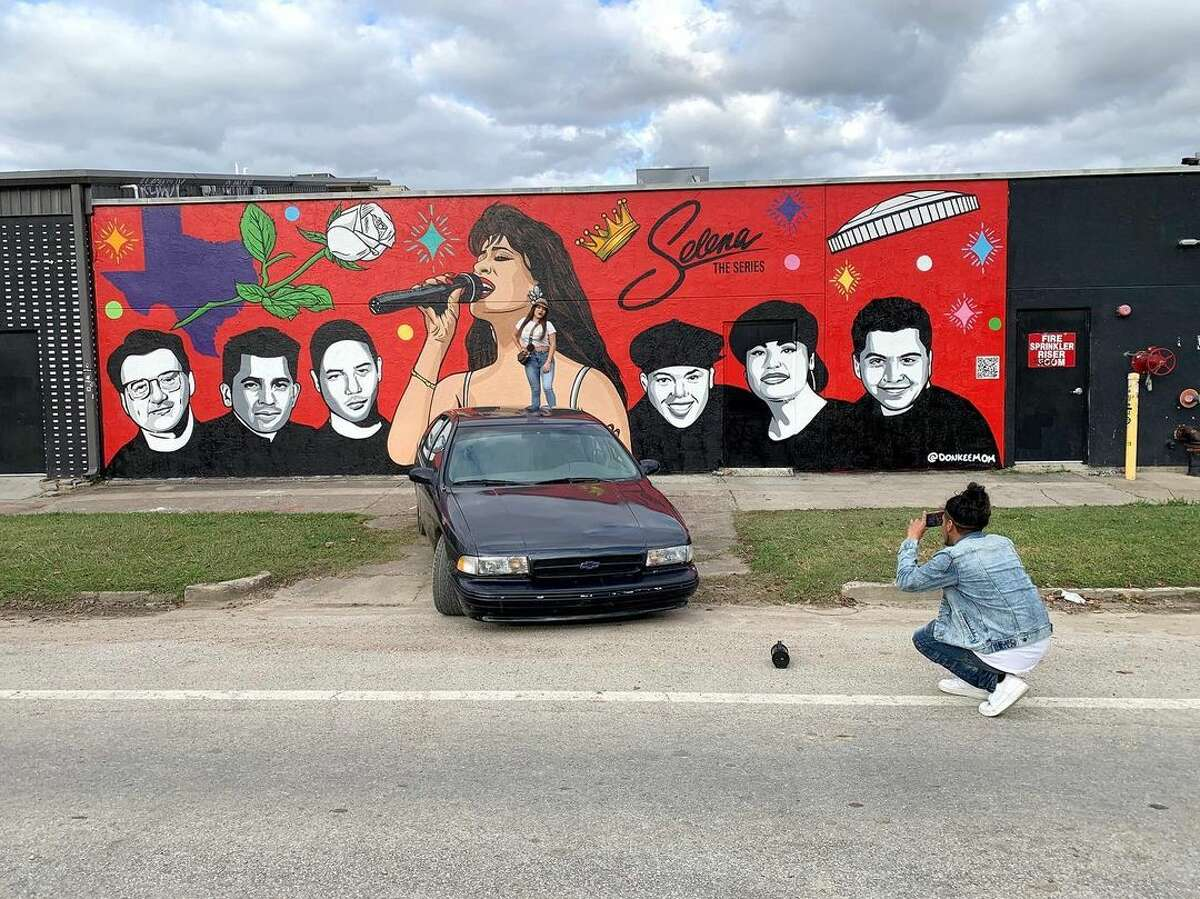 People around town are already stopping to snap a photo with the new Selena mural.