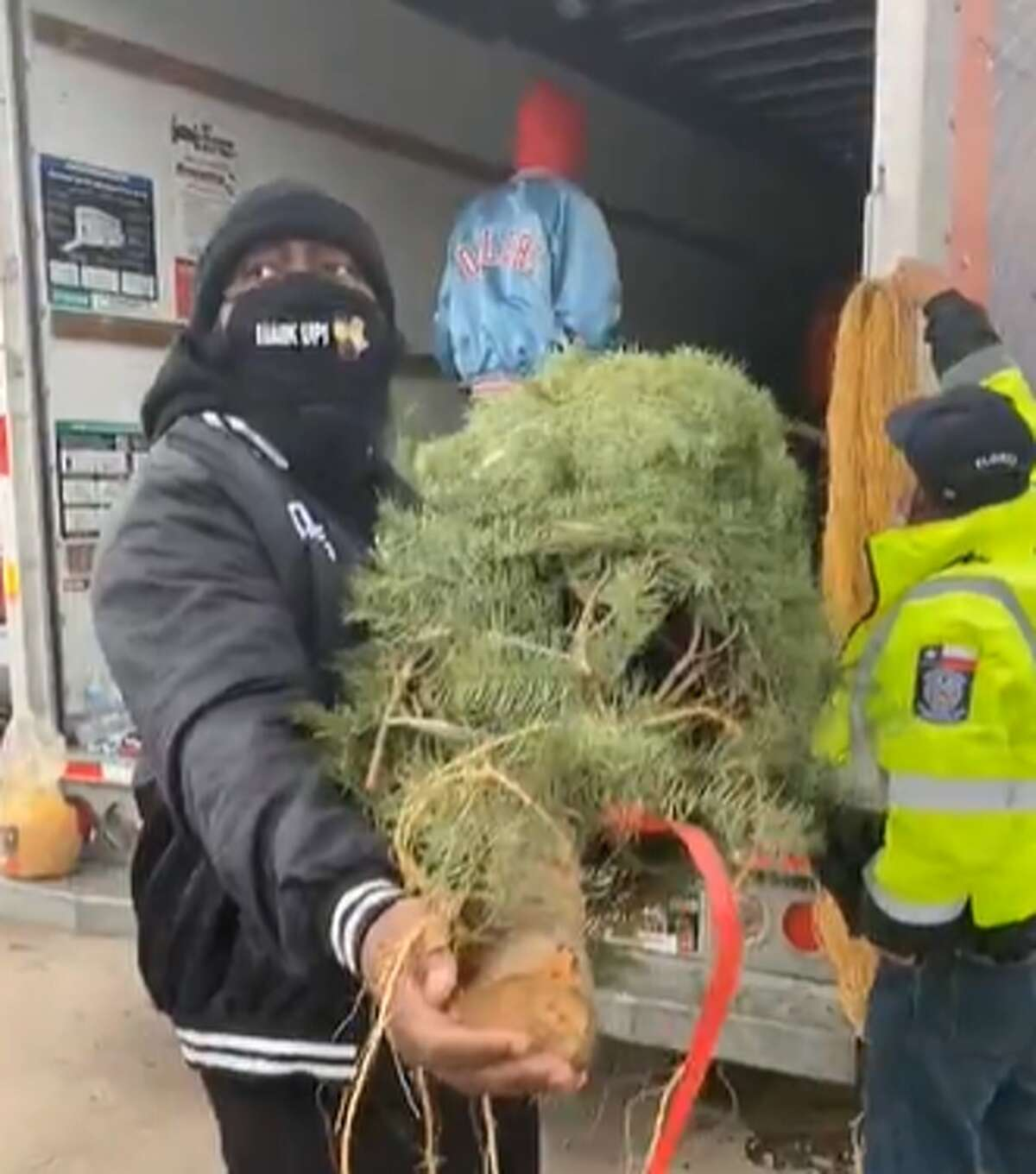 Trae tha Truth and his Relief Gang gave Christmas trees to 100 families during the holidays.