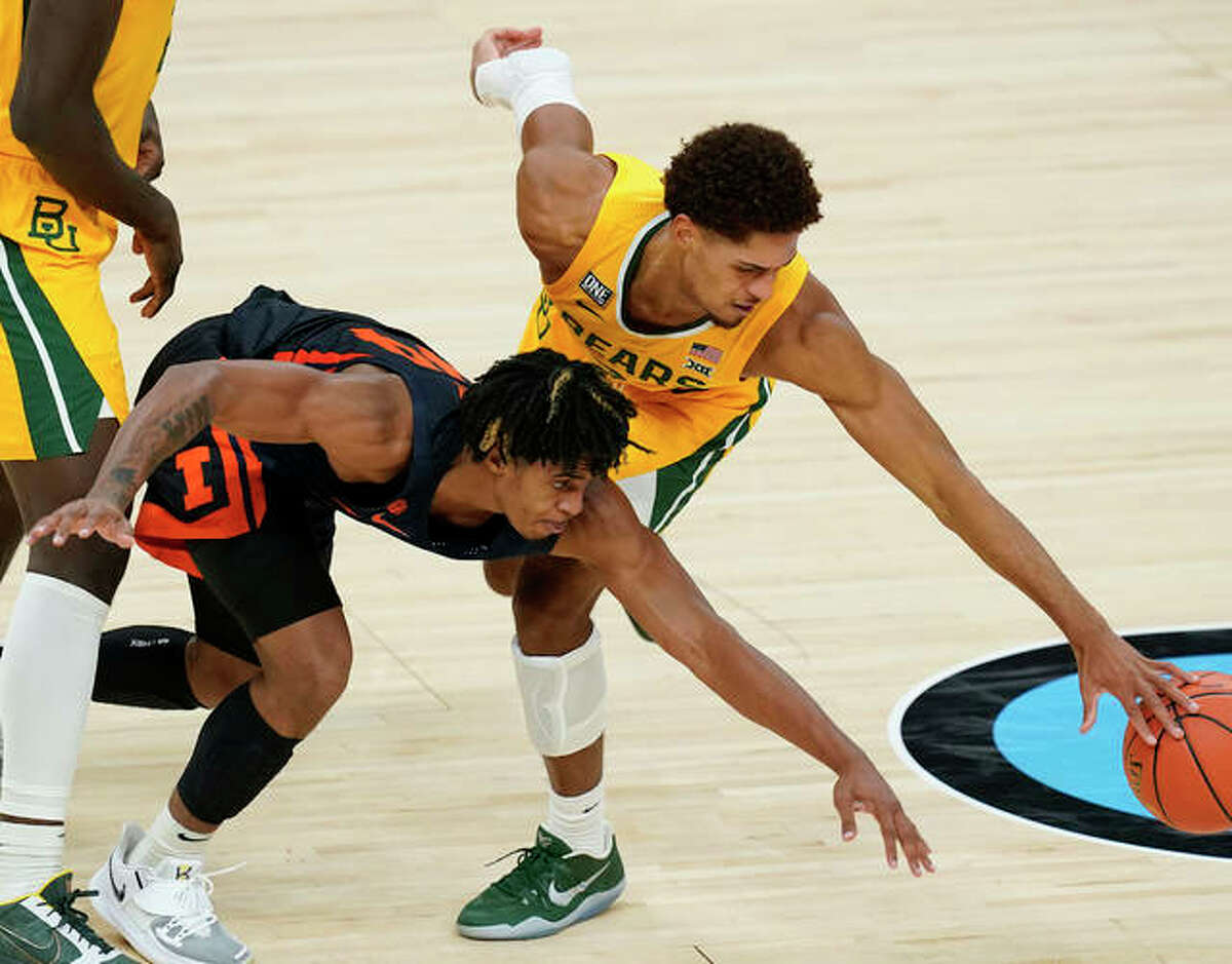 Baylor's MaCio Teague, right, and Illinois' Adam Miller go for a loose ball during the second half of an NCAA college basketball game Wednesday, Dec. 2, 2020, in Indianapolis.