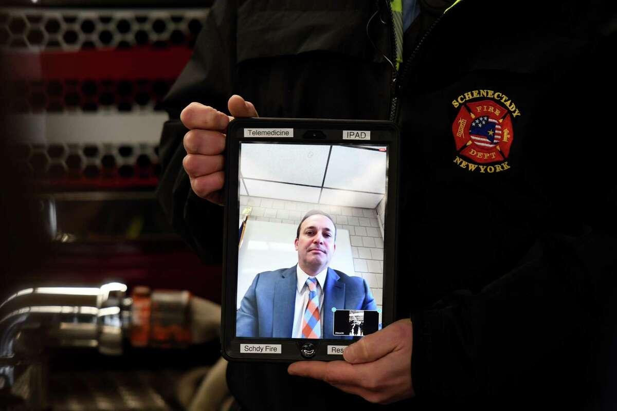 Dr. Michael Bibighaus, founder and chief medical officer of United Concierge Medicine, is seen during a telemedicine demonstration with the Schenectady Fire Department on Monday, Dec. 7, 2020, at Schenectady Fire Headquarters in Schenectady, N.Y. City fire department EMS paramedics will utilize telemedicine through a partnership with United Concierge Medicine. The service offers virtual emergent care via remote video consultations with emergency physicians. (Will Waldron/Times Union)