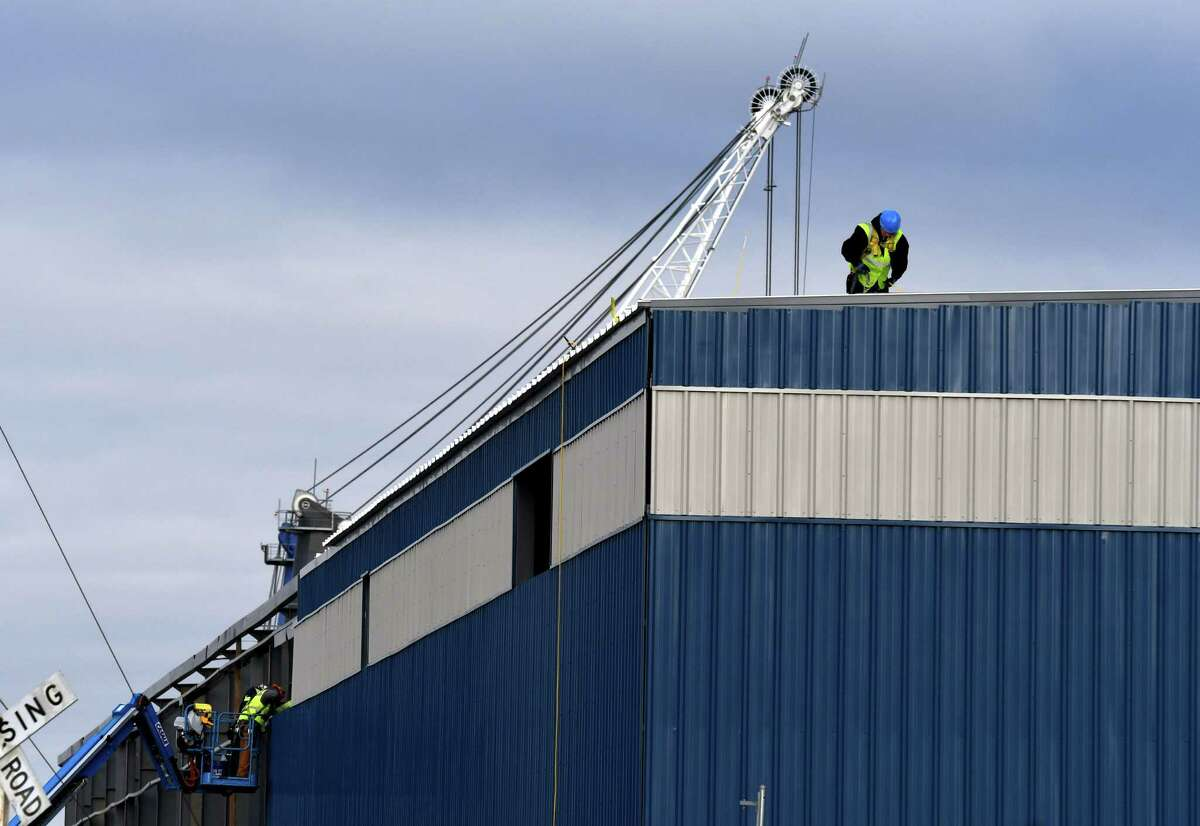 Siding is added to a new warehouse being constructed at the Port of Albany on Monday, Dec. 7, 2020, on Smith Boulevard in Albany, N.Y. (Will Waldron/Times Union)