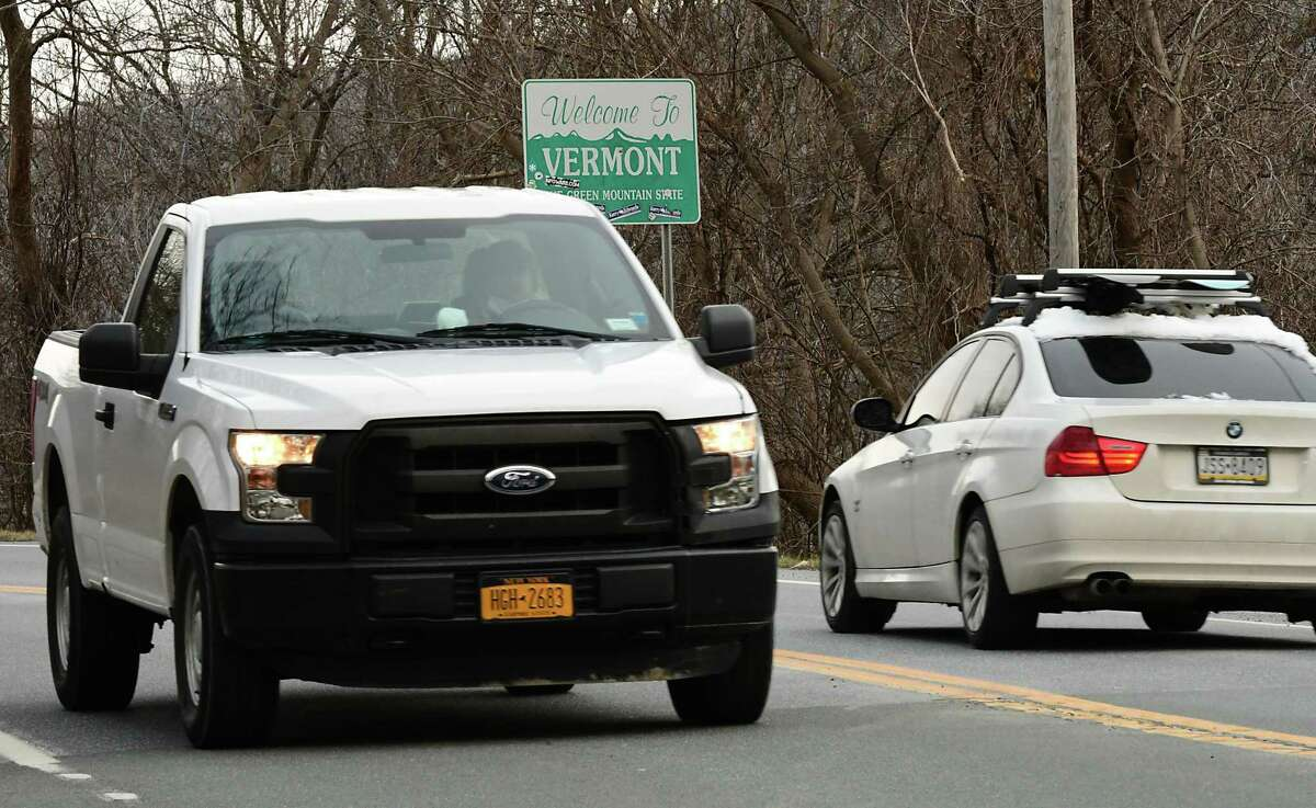 Cars are seen going past the Welcome to Vermont sign on Rt. 7 heading into Bennington on Monday, Dec. 7, 2020 in Hoosick, N.Y. (Lori Van Buren/Times Union)