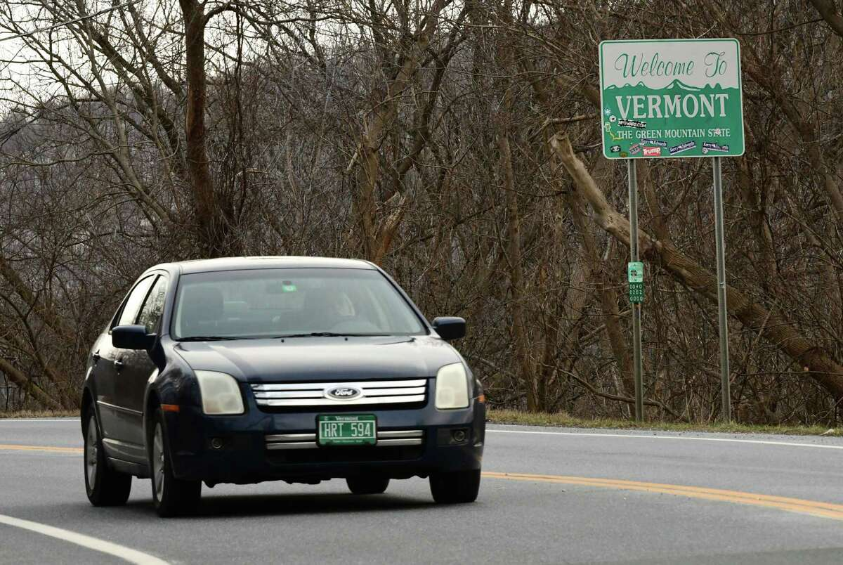 A car is seen going past the Welcome to Vermont sign on Rt. 7 heading into Bennington on Monday, Dec. 7, 2020 in Hoosick, N.Y. (Lori Van Buren/Times Union)