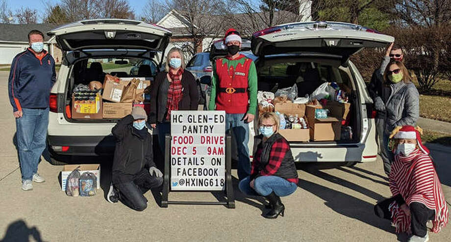Volunteers from the Hunters Crossing and Stallion Drive neighborhoods with the items they collected on Saturday morning for a food drive. The items were donated to Glen-Ed Pantry. Photo: For The Intelligencer