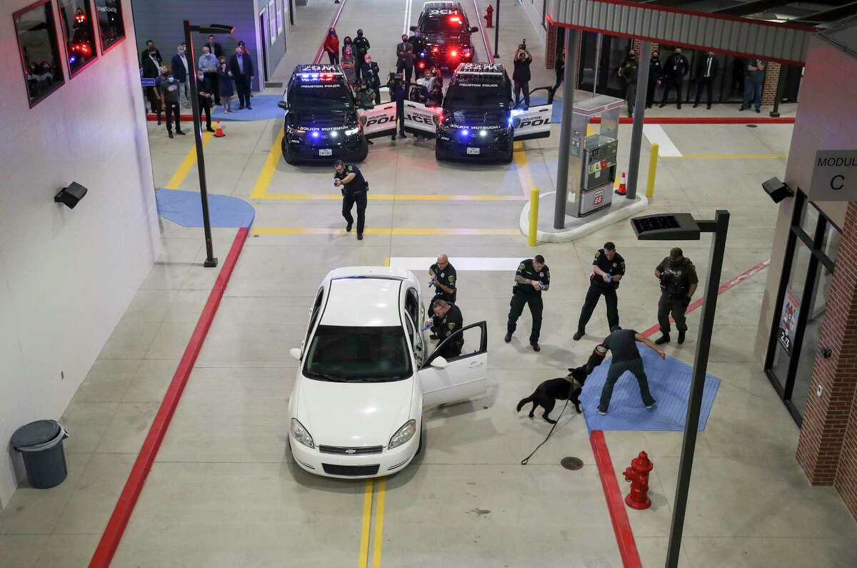 Houston Police officers demonstrate skills related to a traffic stop-based scenario during a ceremony to unveil a new HPD training center Thursday, Nov. 19, 2020, at the Tilman Fertitta Family Tactical Training Center in Houston. The state's training requirements were described as inadequate in a report issued by the Sunset Advisory Commission, but individual departments can do much more than the minimum required.