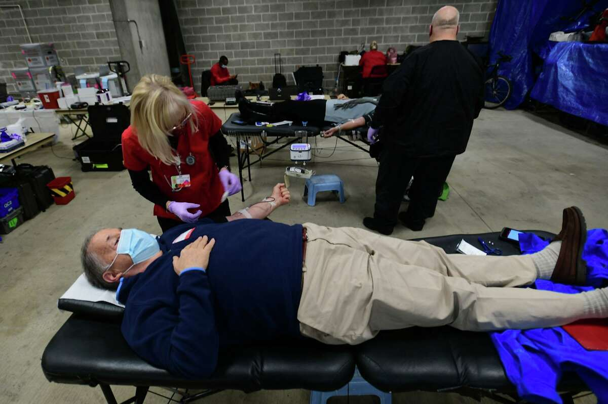 Resident Matt Boardman gives blood as The Greenwich Police Department holds a blood drive Saturday, December 5, 2020, at the public safety complex in Greenwich, Conn. The drive proceeds are donated to the US Marine Corps Reserve Toys For Tots Program. The Department also held a blood drive at the complex where an informal competition between police, fire and EMS to see who can get the most donations.