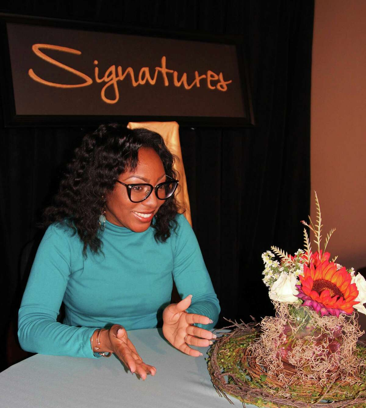 Ashley Bryson, Upper School English faculty member at The John Cooper School, moderates a Q&Awith author Jesmyn Ward after the keynote address at the 16th Signatures Author Series hosted by the school.