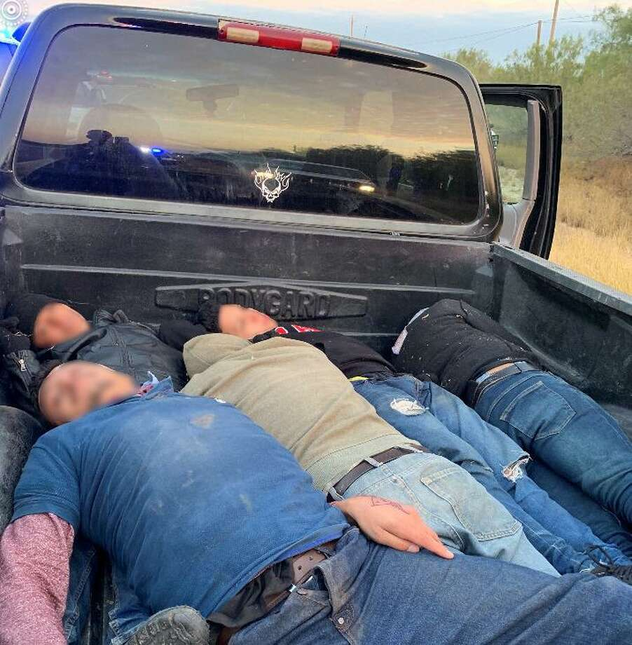 U.S. Border Patrol agents said they discovered this group of immigrants being transported in a black pickup. The driver is facing human smuggling charges. Photo: Courtesy Photo /U.S. Border Patrol