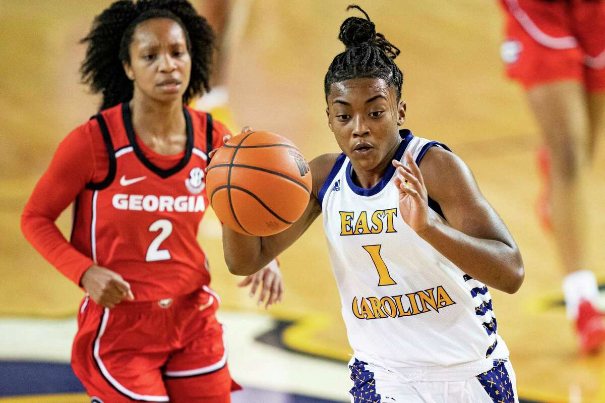 East Carolina's Taniyah Thompson (1) is chased by Georgia's Gabby Connally during their game on Wednesday.
