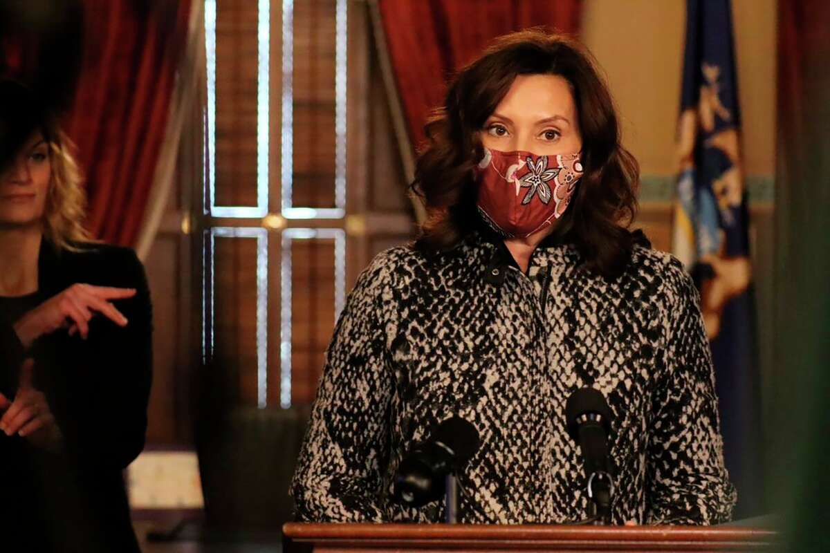 In this photo provided by the Michigan Office of the Governor, Gov. Gretchen Whitmer speaks during a news conference in Lansing, Monday, Dec. 7, 2020. (Michigan Office of the Governor via AP)