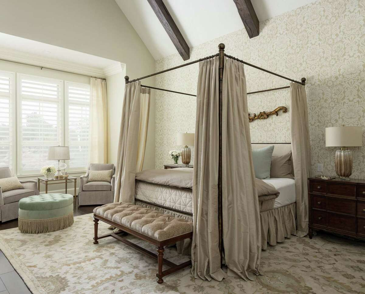 Interior designer April Littmann of Neighbor Interiors is helping Amie and Brian Boster update their home with new decor. The primary bedroom makeover included a new canopy bed and bedding, furniture, paint, wallpaper and beams on the ceiling.
