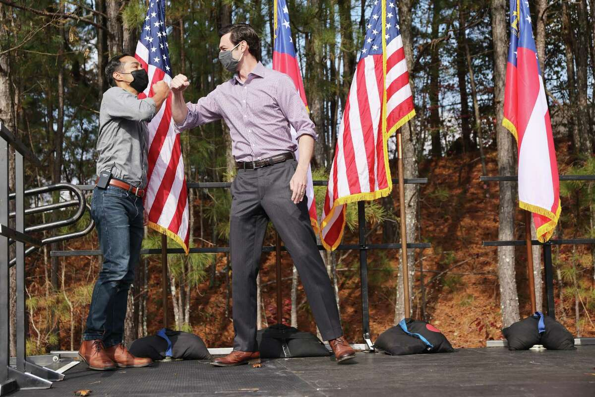 LILBURN, GEORGIA - DECEMBER 07: Former Democratic presidential candidate Julián Castro (L) joins Jon Ossoff, Democratic candidate for the U.S. Senate at a campaign event to register Democrats to vote in the January 5th senate runoff election on December 07, 2020 in Lilburn, Georgia. Ossoff is running against Sen. David Perdue (R-GA) while his fellow Democrat, Rev. Raphael Warnock, is in a closely watched race with Sen. Kelly Loeffler (R-GA). The rally comes ahead of the crucial election which will decide who controls the United States senate. (Photo by Spencer Platt/Getty Images)