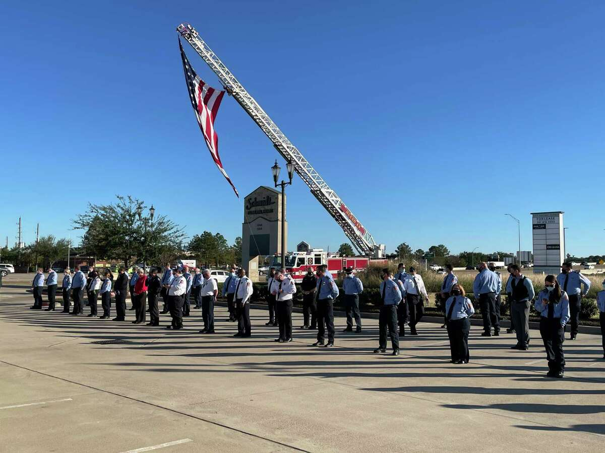 First responders from Harris County ESD No. 48 line up to honor Gordon Baker, a paramedic who died after contracting COVID-19 in the line of duty Dec. 7, 2020, in Katy, Texas.