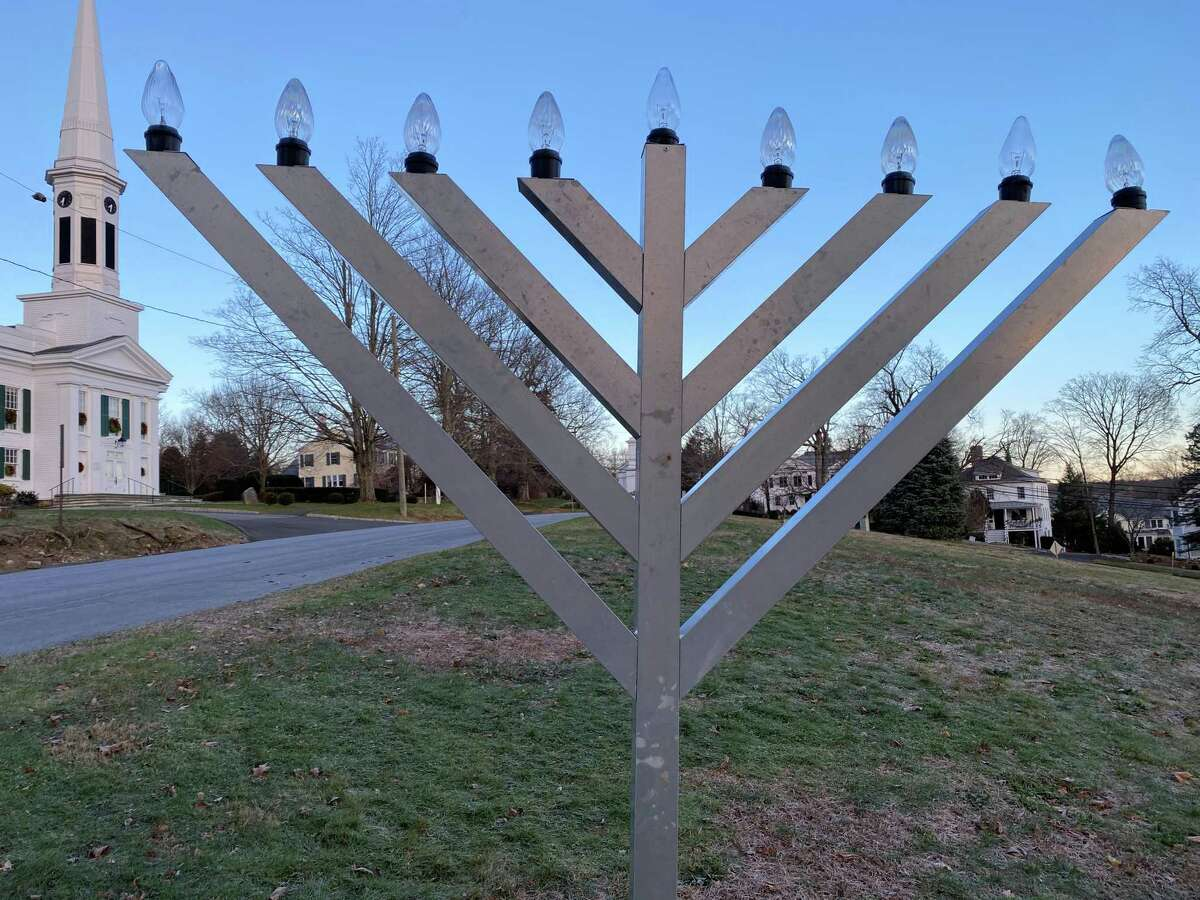 The menorah on God's Acre in New Canaan is ready to be lit, but the tradition of having the New Canaan Fire Department throw candy to children will not take place this year. The picture was taken Monday, Dec. 7.