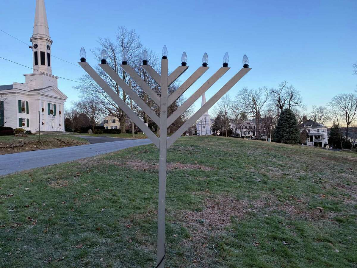 The menorah on God's Acre in New Canaan is ready to be lit, but the tradition of having the New Canaan Fire Department throw candy to children will not take place this year. The picture was taken Monday, Dec. 7, 2020.