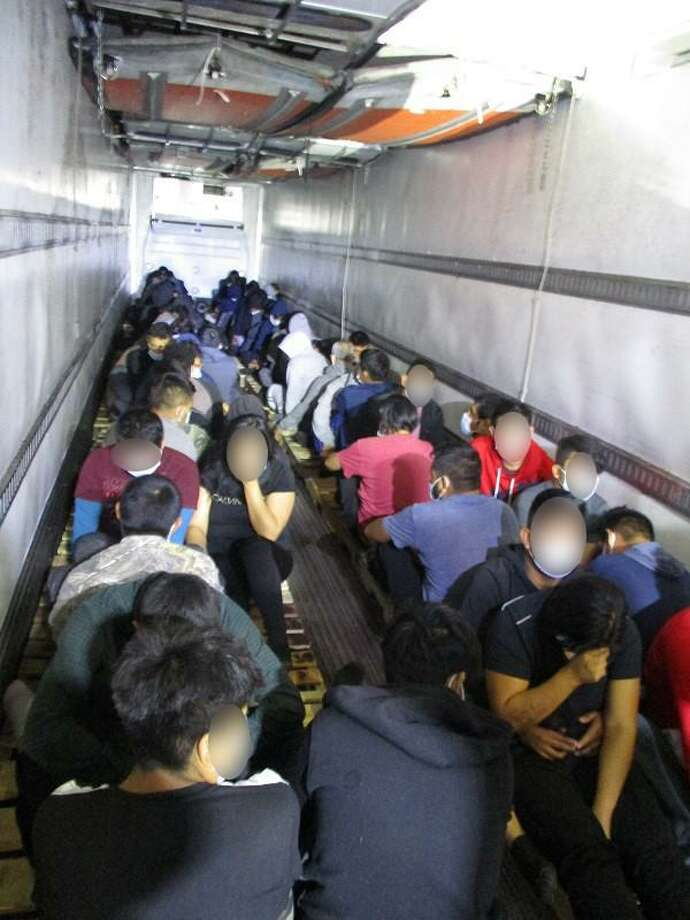 U.S. Border Patrol agents discovered these 80 individuals inside a trailer at the Interstate 35 checkpoint. Agents said all were determined to be immigrants who had crossed the border illegally. Photo: Courtesy Photo /U.S. Border Patrol
