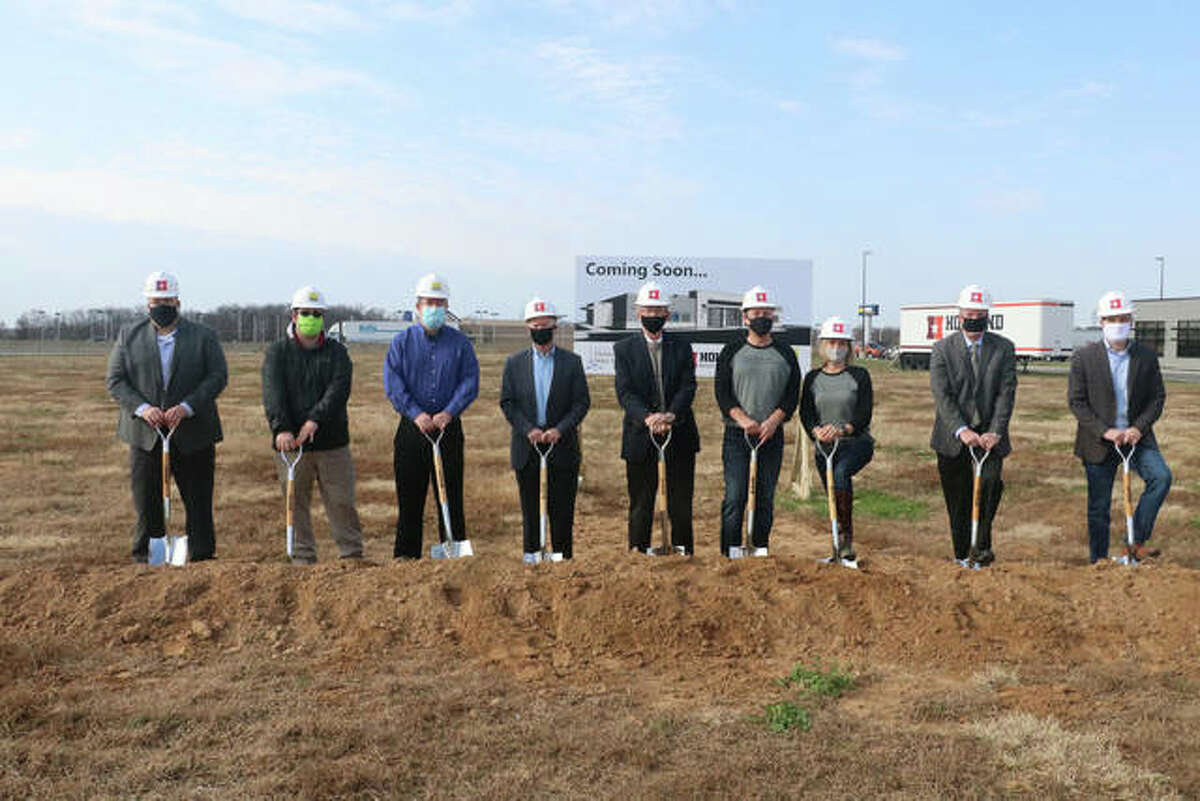 Holland Construction Services breaks ground on a new Metro East Dermatology & Skin Cancer Center in O'Fallon. (L to R): Eric Paulek, Holland Construction Services; Alex Carter, ACI Boland; Tom Goedecke, ACI Boland; Bruce Holland, Holland Construction Services; Mayor Herb Roach; Dr. Jamie McGinness, Metro East Dermatology; Jackie McGinness, Metro East Dermatology; Mike Marchal, Holland Construction Services; Mike Deihl, Holland Construction Services.