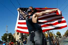 Dave Gifford dances with an American flag as people celebrate in the streets after Joe Biden was announced to have won the Presidential race on Saturday, November 7, 2020 in the Castro neighborhood of San Francisco, Calif.