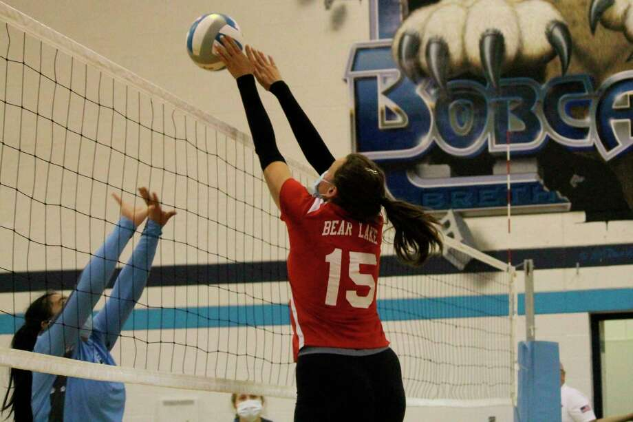 Lilli Riesenberg leaps up to make a block at the net against Brethren on Oct. 1. (File photo)