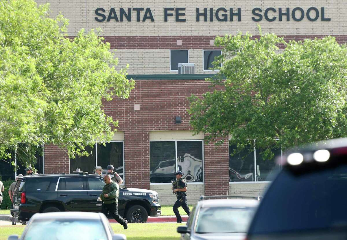 Law enforcement officers respond to Santa Fe High School after an active shooter was reported on campus, Friday, May 18, 2018, in Santa Fe, Texas. ( Steve Gonzales/Houston Chronicle via AP)