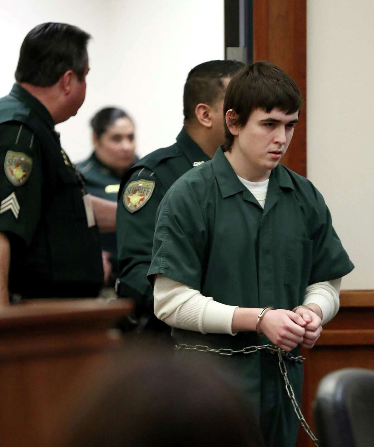 Dimitrios Pagourtzis, the Santa Fe High School student accused of killing 10 people in a May 18 shooting at the high school, is escorted by Galveston County Sheriff's Office deputies into the jury assembly room for a change of venue hearing at the Galveston County Courthouse in Galveston, Texas on Monday, Feb. 25, 2019. (AP Photo/Jennifer Reynolds, Pool)
