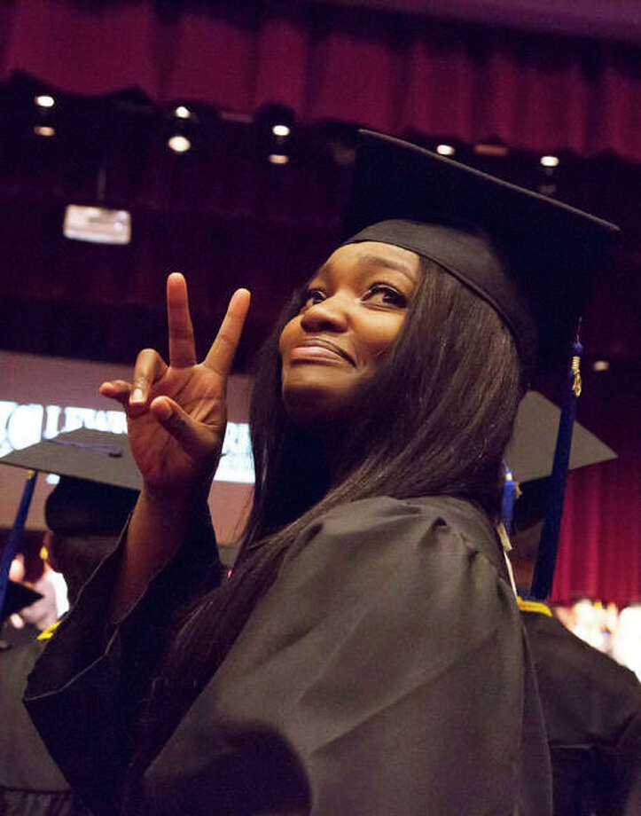 A 2019 graduate of Lewis and Clark Community College acknowledges her guests in the Hatheway Cultural Center's Ann Whitney Olin Theatre during the 48th annual commencement, May 15, 2019.
