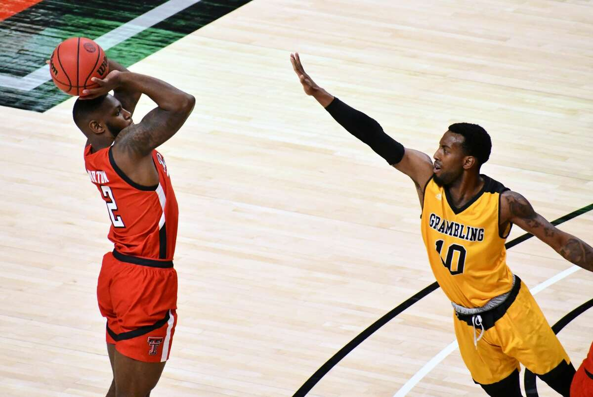 Texas Tech's Jamarius Burton shoots over Grambling State defender Trevell Cunningham during their Division I men's college basketball game on Nov. 6, 2020 in United Supermarkets Arena in Lubbock.