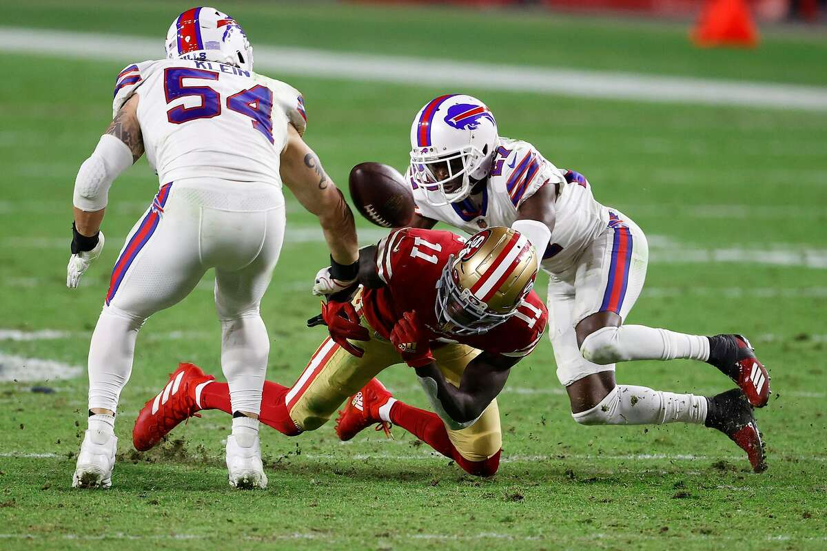 Wide receiver Brandon Aiyuk #11 of the San Francisco 49ers has a pass broken up by cornerback Tre'Davious White #27 and outside linebacker A.J. Klein #54 of the Buffalo Bills during the third quarter of a game at State Farm Stadium on December 07, 2020 in Glendale, Arizona.