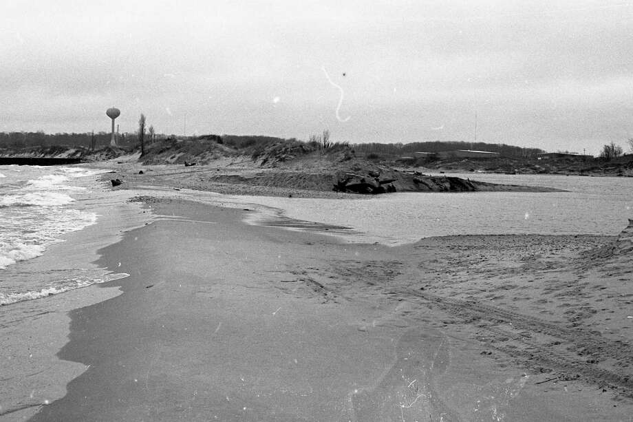 From 40 years ago, the dune that once separated Lake Michigan from the northside's Man Made Lake is now gone, a victim of heavy wind and wave action. (Manistee County Historical Museum photo)