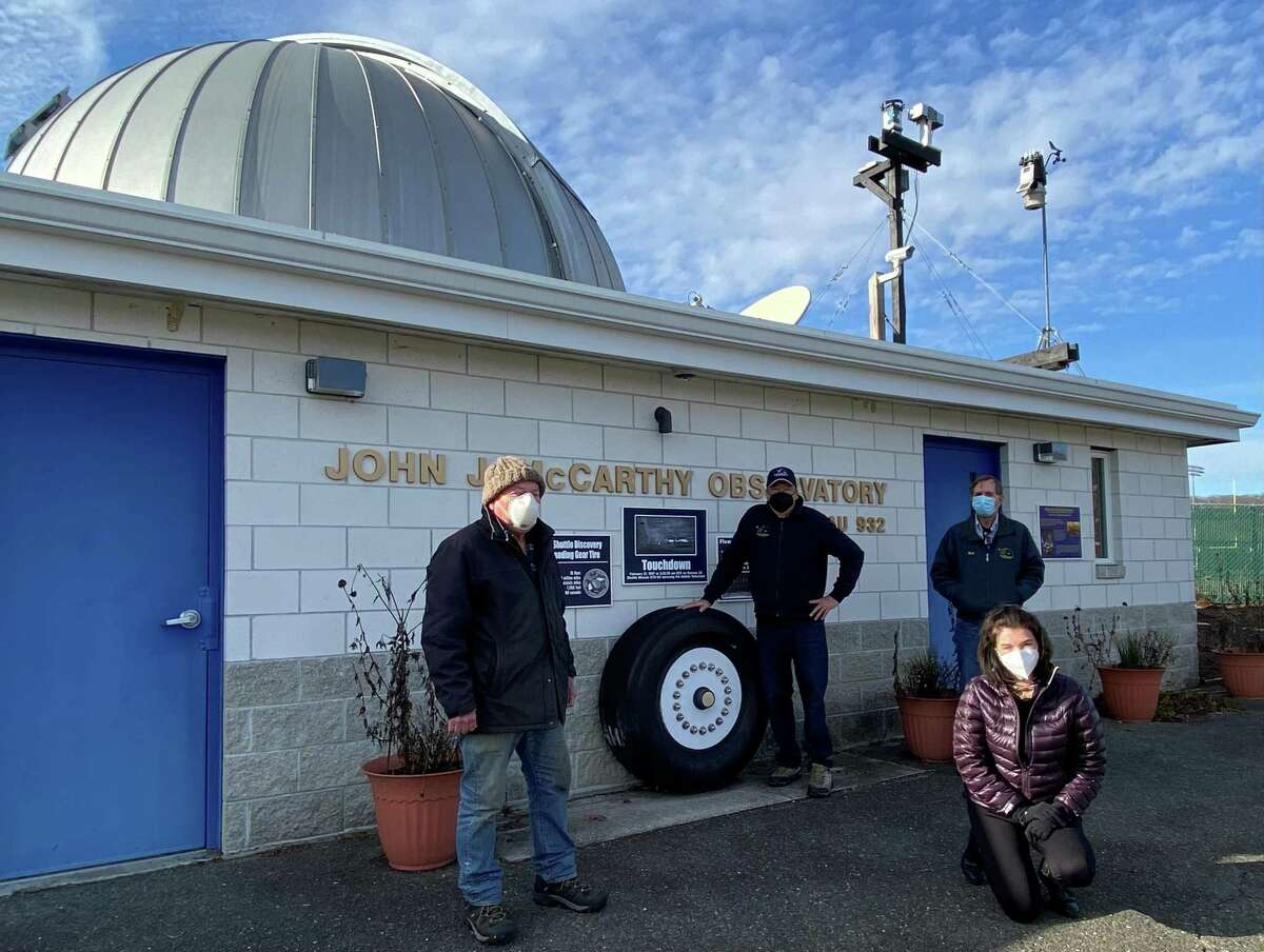 The McCarthy Observatory on the New Milford High School campus is celebrating its 20th anniversary this month. Volunteers from left are, Monty Robson, Bob Lambert, Elaine Green and Bill Cloutier.